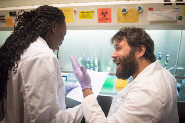 Dr. Berenice Mbiribindi and colleague in the Transplant Immunology Lab