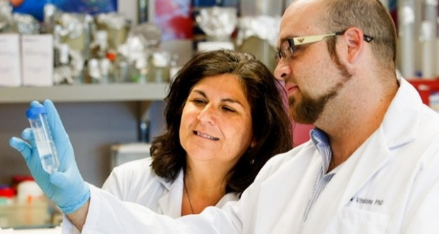 Dr. Olivia Martinez works with a postdoc in the TIL
