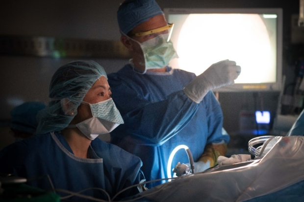 Abdominal Transplantation Surgeon Dr. Marc Melcher instructs a fellow during surgery.